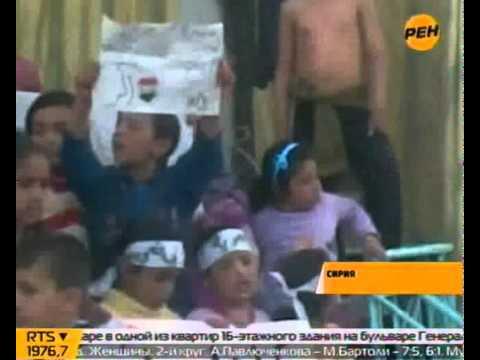 На митинг в Сирии вышли дети